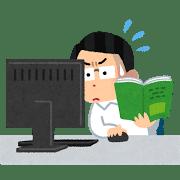 パソコンのマニュアルを読む男性